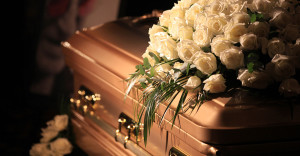Photo of a coffin. Links to the page which lists our available coffins.